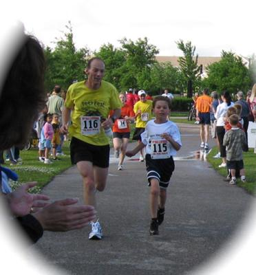 My son and I finishing a 5K in spring of 2008
